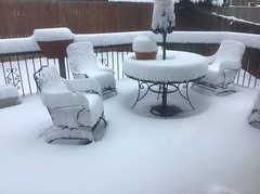 April 15, 2020 - A snow-covered deck. (Ginger Inskeep Riley)