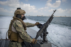 ASailor stands watch on a Mark VI patrol boat before a weapons sustainment exercise in the Arabian Gulf, April 16, 2020