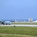 A U.S. Air Force MC-130J Commando II taxis down the flight line on Kadena Air Base, Japan