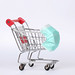 Shopping trolley with medical mask. Coronavirus shopping concept