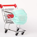 Shopping trolley with medical mask. Coronavirus pandemic, COVID-19 shopping concept