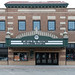 We are all in this together message on the theatre marquee of the Paradise Center for the Arts in downtown Faribault, Minnesota