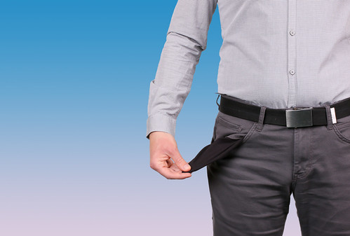 Man showing his empty pockets, From FlickrPhotos