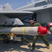 U.S. Marines load AGM-84D Harpoon missiles onto a F/A-18 Hornet aboard MCAS Iwakuni