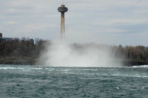 Mist and Niagara River as the Water falls over the Edge of Niagara Falls, Canada