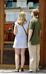 Tourist couple choosing the meal at a restaurant