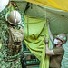 Sailors install a room divider in a berthing tent for the EMF staff in support of DoD's COVID-19 response