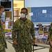 Naval Base Guam Chaplain LCDR Kyu Lee gives a tour to U.S. Pacific Fleet Commander Adm. John Aquilino