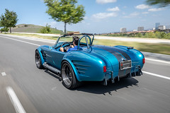 Superformance-MKIII-R-Cobra-Driving-Rear-View-Scenic-Backdrop