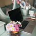 Flowers and macbook in glamour room.