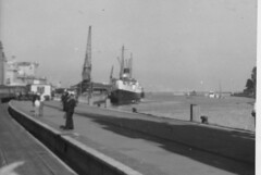 Weymouth Quay 1957 with a train on the tramway and the TSS St Julien awaiting passengers at quayside