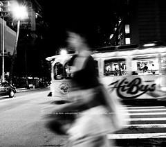 Street lamp. bus. Woman.