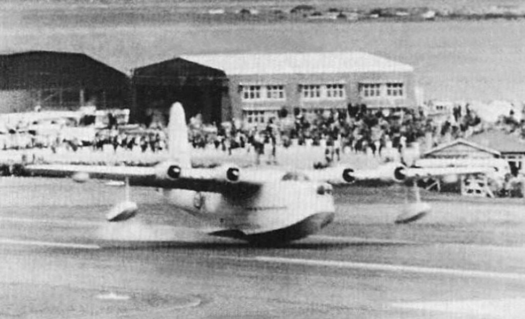 "Sunderland NZ4113 does a ""touch and go"" during the Opening Day Airshow at Wellington International Airport, Rongotai, Wellington, Sunday 25 Oct 1959."