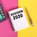 Recession 2020 text in notebook on colorful background
