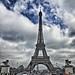 Paris France  -  Eiffel Tower - Parisian Landmark - Exposition of 1889 - Cloudy Day