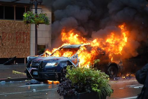 Burning Seattle Police Car by marcoxu0109, on Flickr