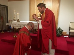 Newly ordained Fr. Holland blesses his classmate Fr. Petrone, at the Carmelite Monastery on the Feast of Pentecost, May 31, 2020.
