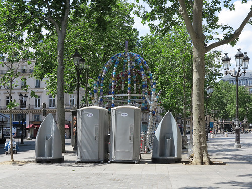 Original temporary toilets dominating the Place Colette