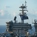 """USS Theodore Roosevelt (CVN 71) flies a """"Don't Give Up the Ship"""" flag."""