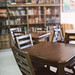Wooden chairs and table in the library.