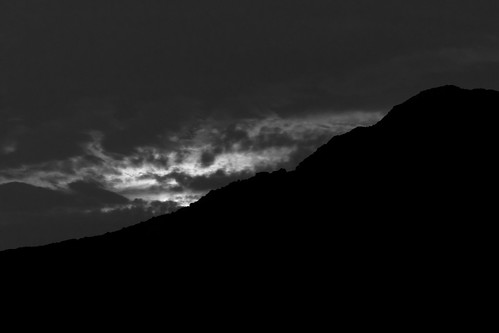 invisible full moon behind the clouds at Pic Saint Loup