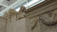 Ara Pacis Augustae, lion-griffin and relief fragment with two men, one wearing toga and veiled