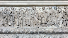 Ara Pacis Augustae, four flamines stand together (left), a flaminius lictor with ax over shoulder, Agrippa in high relief (center), Livia or Julia (behind Agrippa)