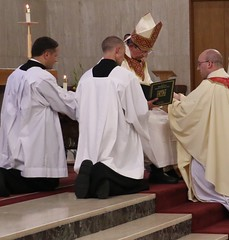 Bishop annoints hands of Fr. Petrone