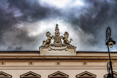 Sculpture above the entrance to the Uruski Palace located by Krakowskie Przedmieście in Warsaw, Poland.  351-Edita