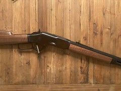 Winchester 1873. Reblued, new wood. Rifle was in a fire