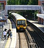 Southeastern Train No.465185 heads away from the down-platform at Bexleyheath en-route for Dartford