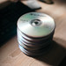 Group of compact disk on wooden table.