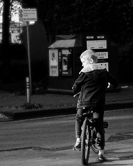 Stop | Boy waiting to cross the street with his bike