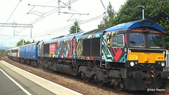 Photo of 66718 'Sir Peter Hendy CBE' with Barrier coach 6394, Mk3 coaches 42205 and 42210, barrier coach 6393, 5Z43, Craigentinny T.&R.S.M.D to Bo'ness Exchange Sdgs Gbrf at Camelon.