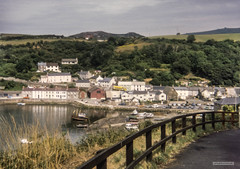 Photo of Lower Fishguard harbour with Preseli Hills on the horizon, Pembrokeshire, Wales.