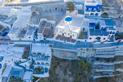 Santorini from above: the white and blue houses and terraces of Firá