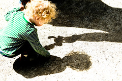 Photo of Molly inspects her shadow