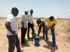 ICRAF World Vision and CARE project staff taking soil samples for analysis of soil organic carbon and other land degradation indicators. Photo World Agroforestry