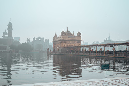 Amritsar India - Febuary 8, 2020: Crowds of people get in line to enter the Sikh Golden Temple (sri harmandir sahib)