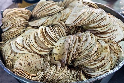 Big bowl of chapati - traditional Indian bread at the Golden Temple (sri harmandir sahib) in the Langar (Kitchen)