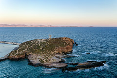 Aerial shot: the islet of Palátia, at the entrance to Naxos harbour, with the Portara, symbol of the island