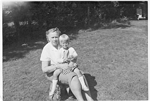 Laura and Cindy c1963 My grandmother, Laura Mae (Smith) and my sis, Cindy. This is sitting on the tree stump that I remember well in the backyard at 62 Burk Street in Oshawa. I had many a photo taken sitting on that tree stump! . . . . #family #genealogy