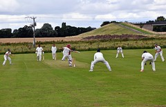 Photo of South Kilvington CC: Ball and batsmen swinging away