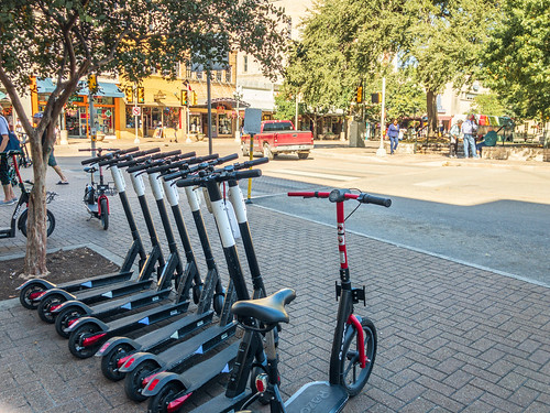 Row of rental scooters at Alamo Square