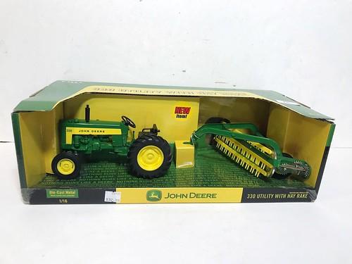 New John Deere 330 Utility w/ Hay Rake ($62.70)