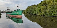 Photo of 7th August 2020.  Arklow Valour leaves Irlam Locks on the Manchester Ship Canal, Irlam, Salford, Greater Manchester.
