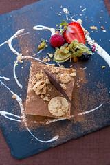 Top view of Italian tiramisu with hazelnut cream and crunchy chocolate. Q11 restaurant, Pollença, Majorca