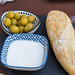 Spanish tapas: bread with aioli and olives at Q11 restaurant in Pollença, Mallorca