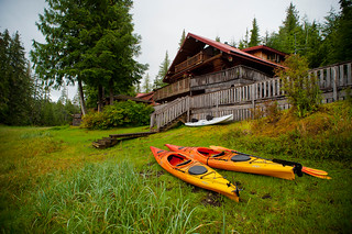 Copy of Lodge Exterior - Kayaks on Grass - Front of Lodge