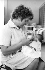 Photo of Auxillary Nurse, Eileen Carter, Gives Baby Jeannie A Helping Hand, All Saints Hospital, Chatham,